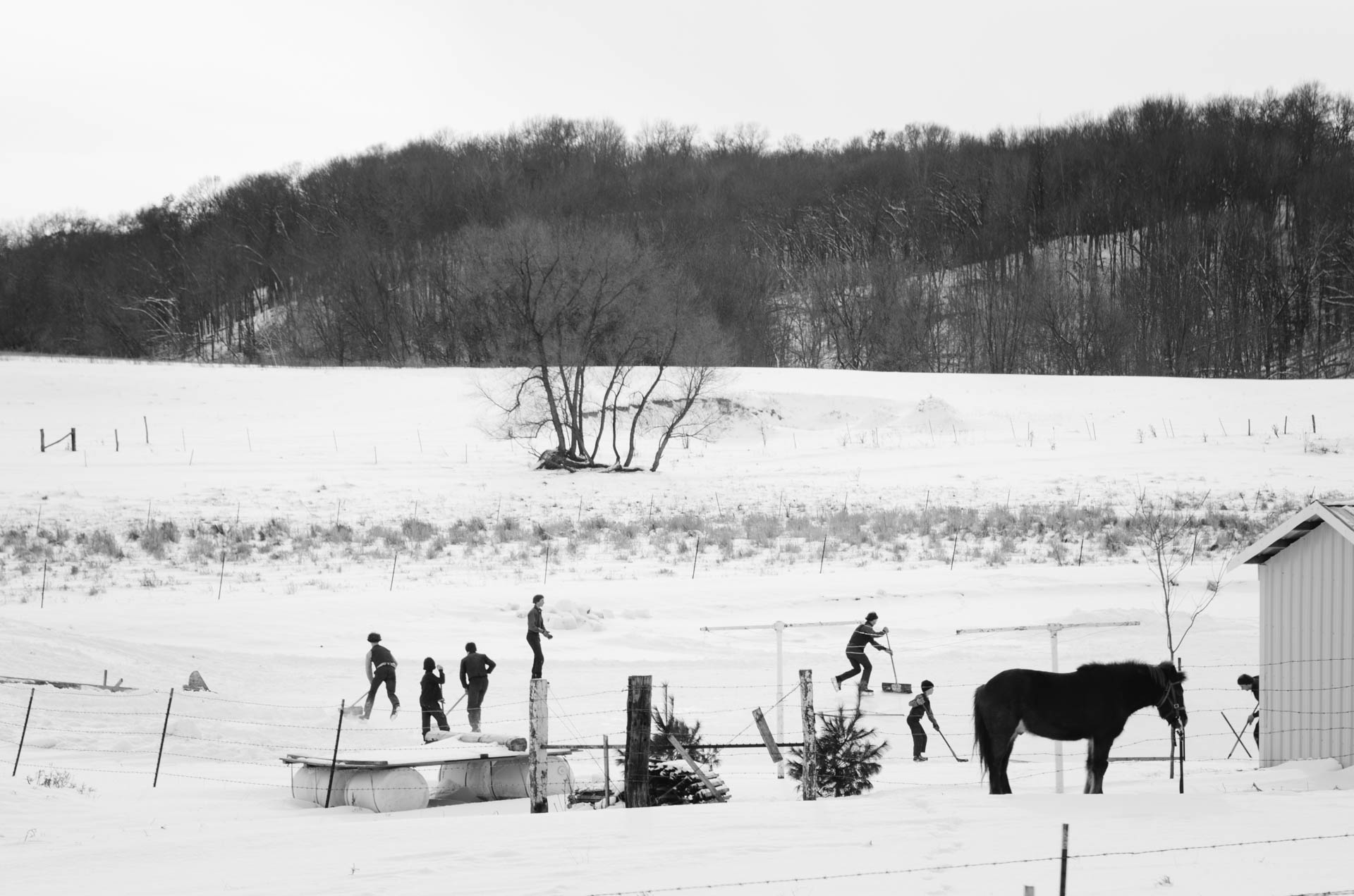 amish-kids-playing-pond-hockey-winter-augusta-wi