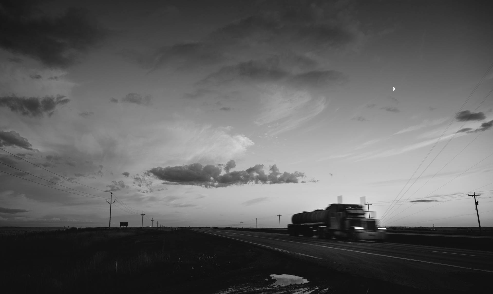 bakken-crude-oil-trucking-speeding-down-highway-at-sunset