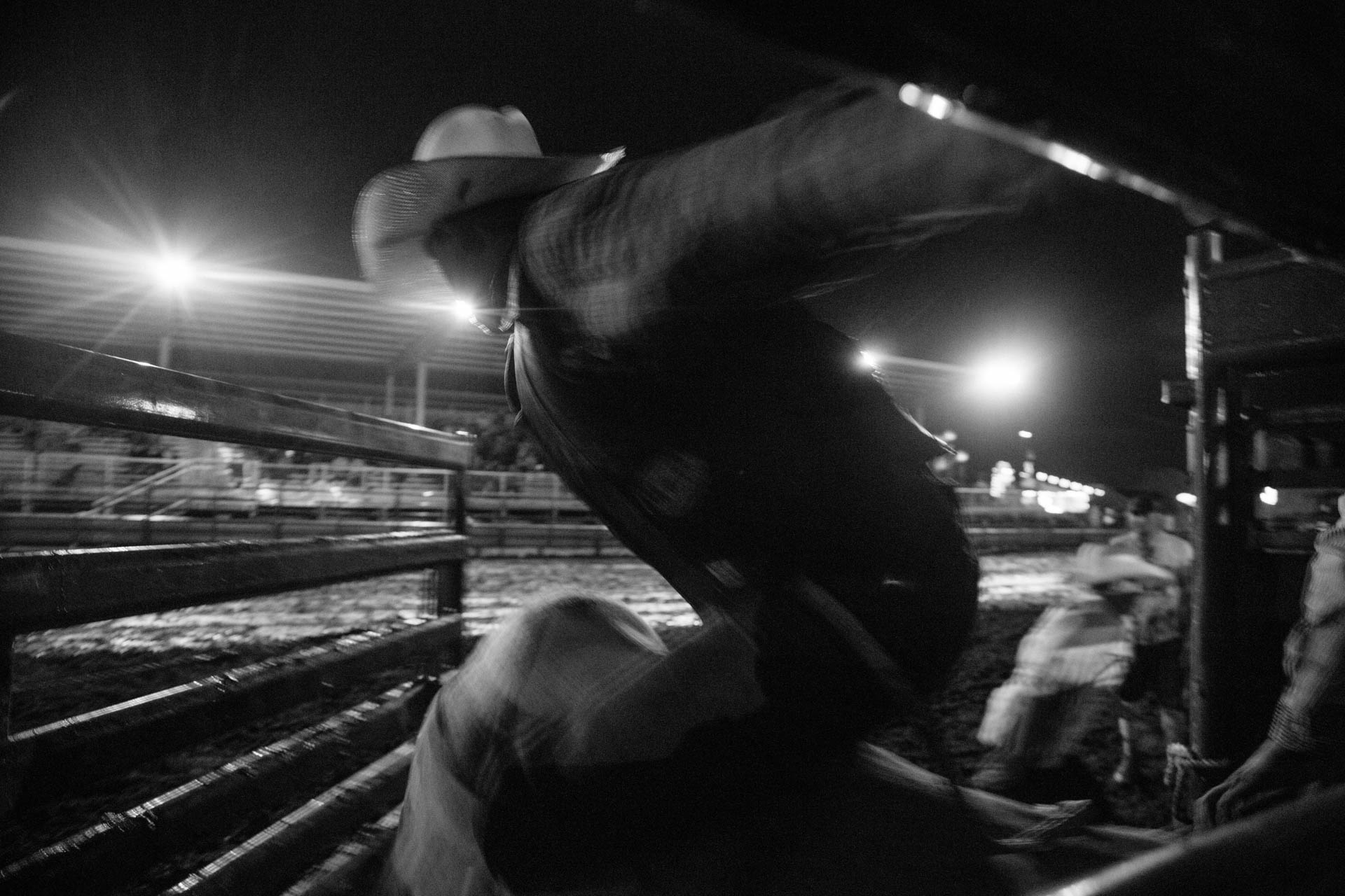 bull-rider-flies-out-of-chute-blur-a5377