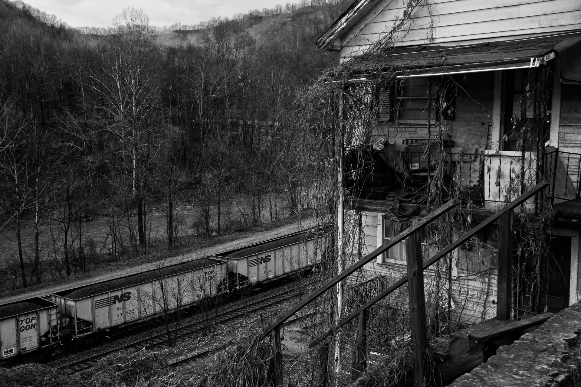 decaying-house-overlooking-railroad-yard-capels-wv-.JPG
