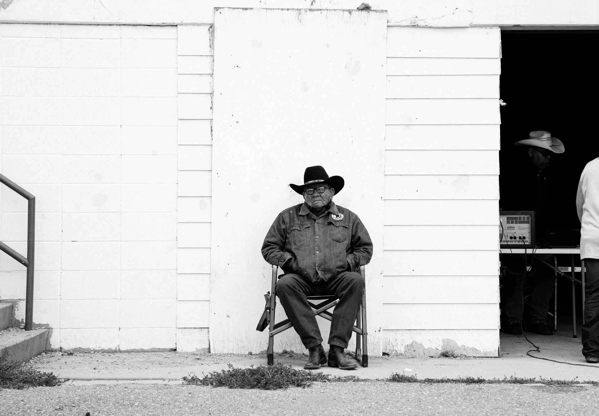 elder-with-cowboy-hat-sitting-alone.JPG
