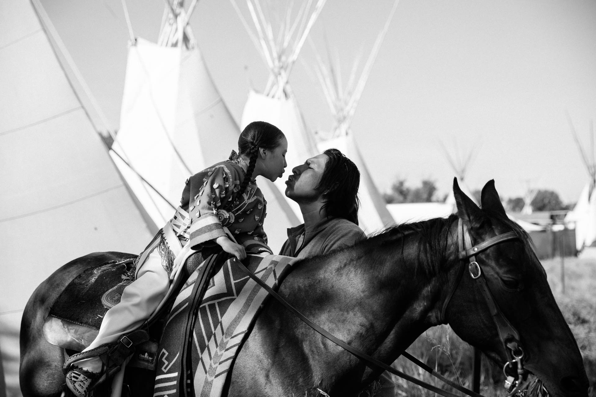 native-american-father-kissing-daughter-tee-pee-horse.JPG