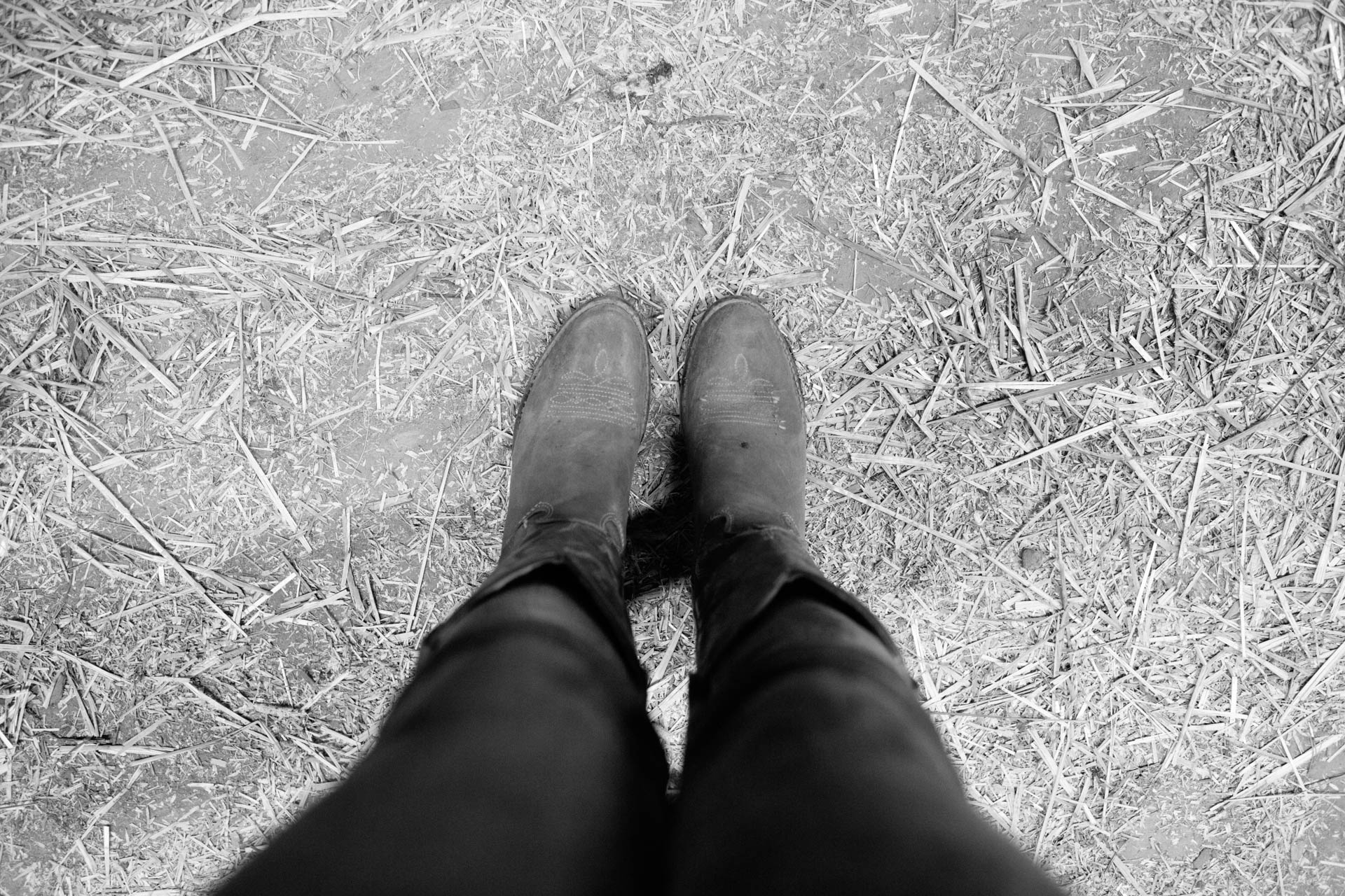northern-wisconsin-state-fair-looking-down-at-her-cowboy-boots