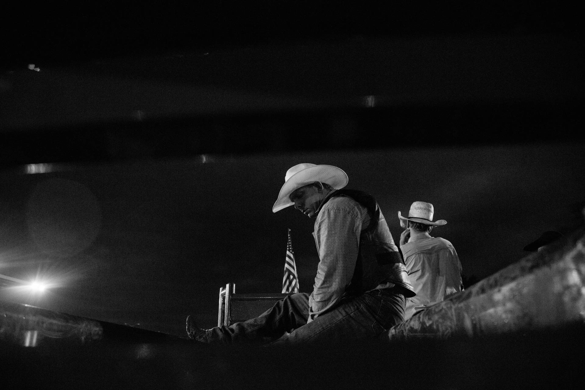 rough-nite-at-the-rodeo-sitting-on-chutes-a5291